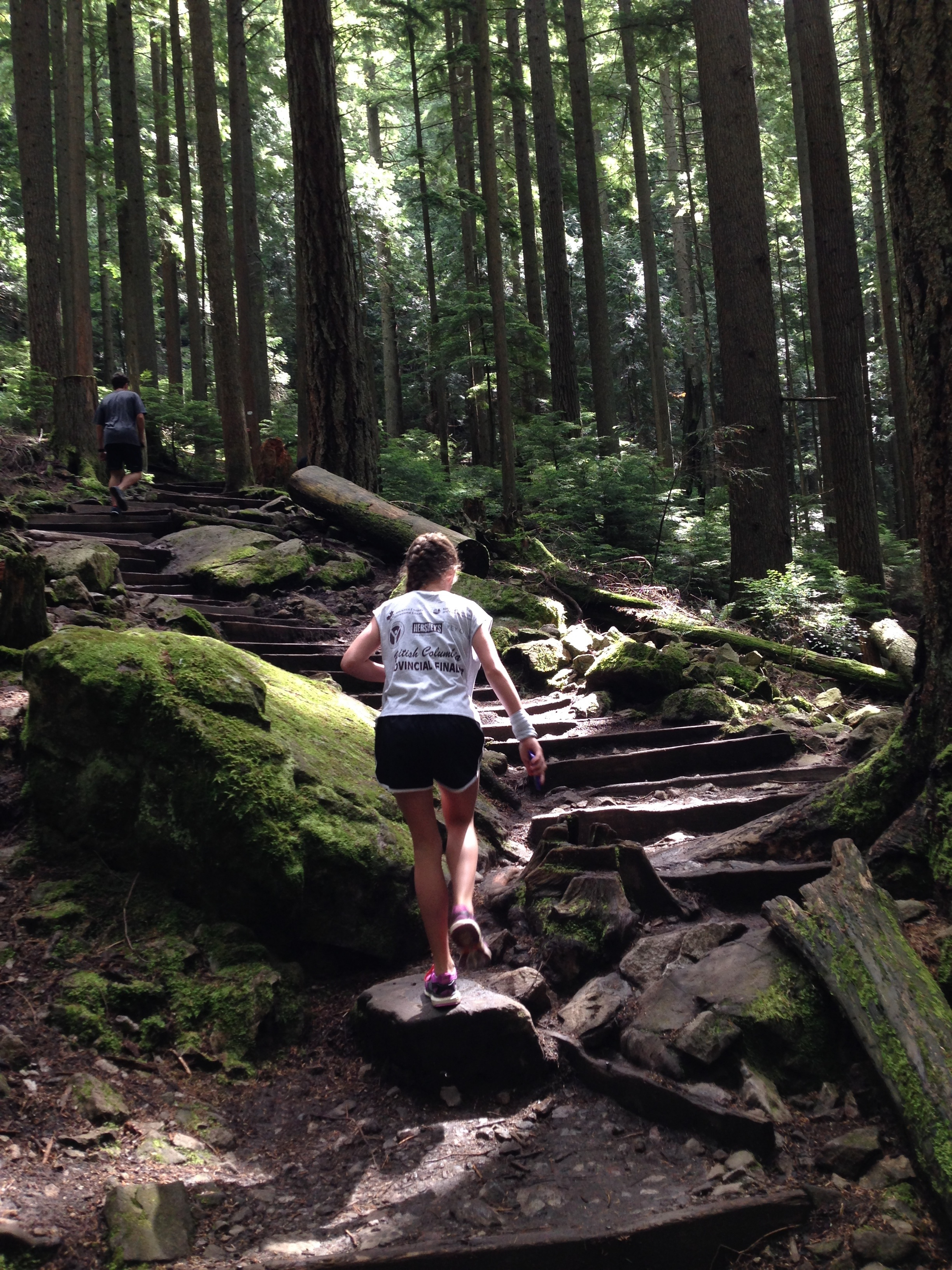 a young woman climbing the stairs at Grouse Grind.